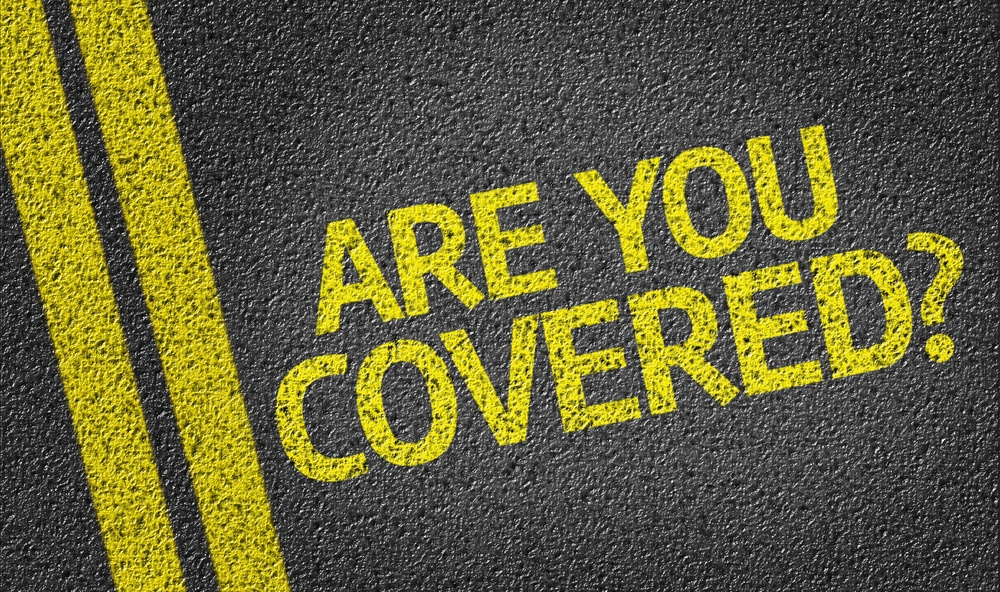 Are you Covered written on the road