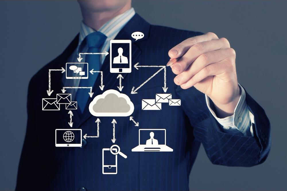 Image of businessman drawing business plan. Computing concept.jpeg
