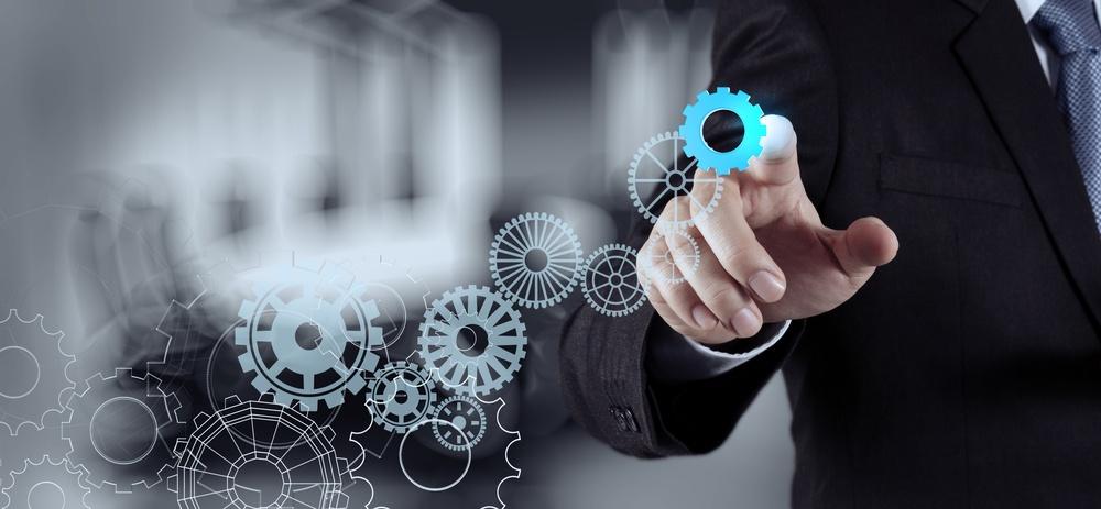 businessman hand draws gear to success concept.jpeg